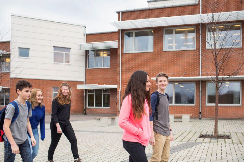 children-12-13-in-front-of-school-building-6PRCE4K (1)