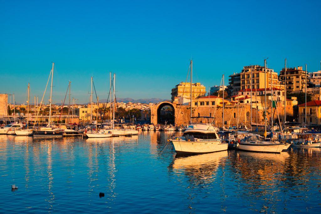 Venetian Fort in Heraklion and moored fishing boats, Crete Island, Greece