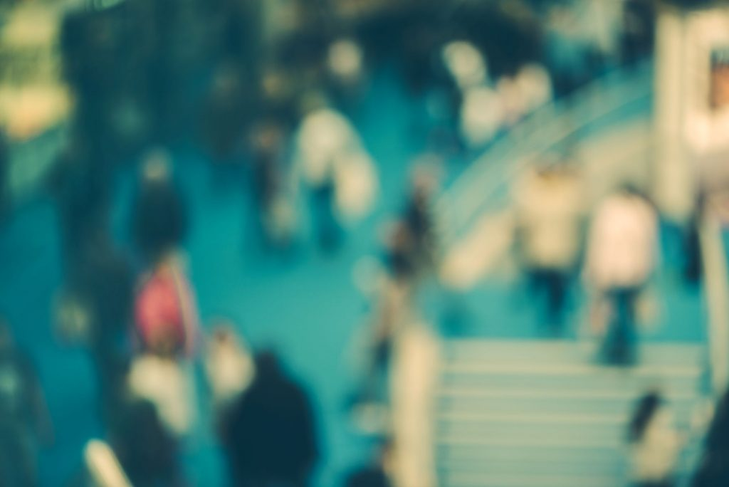 abstract-blurred-people-in-exhibition-hall-event-P6D93WC