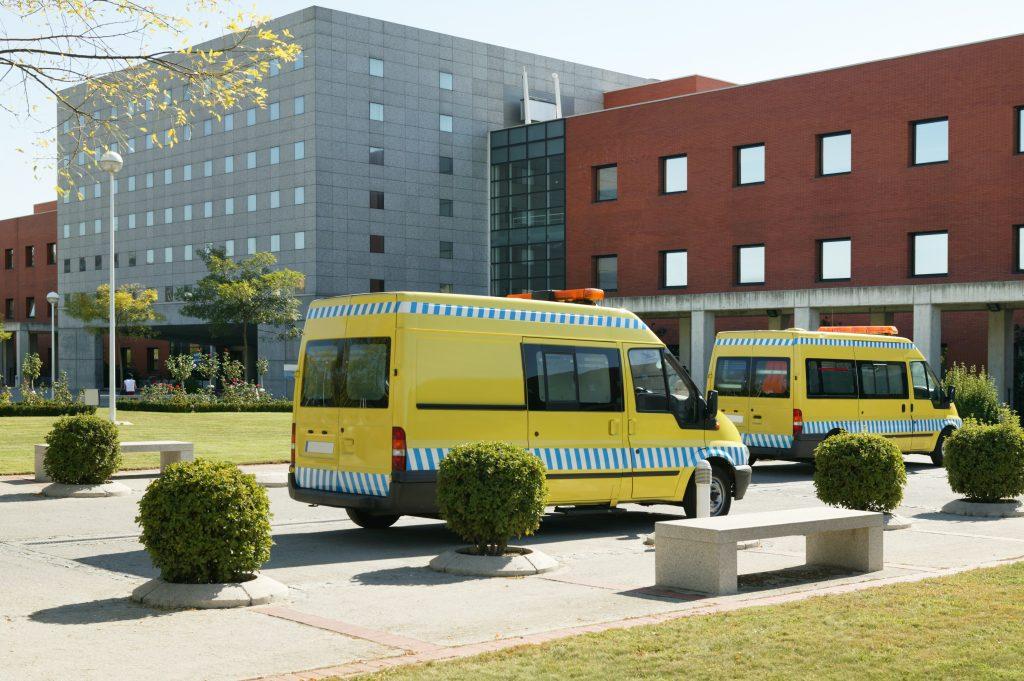 Ambulance vehicles on an hospital parking. Emergency transport