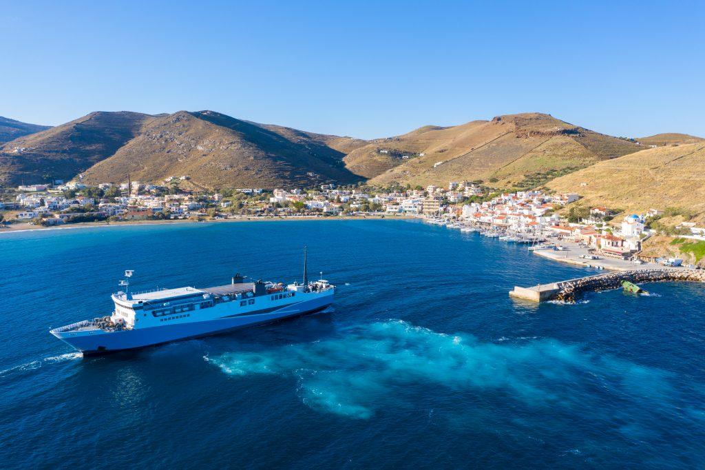 Ferry boat leaving Kea, Tzia island port, Greece. Aerial drone view.