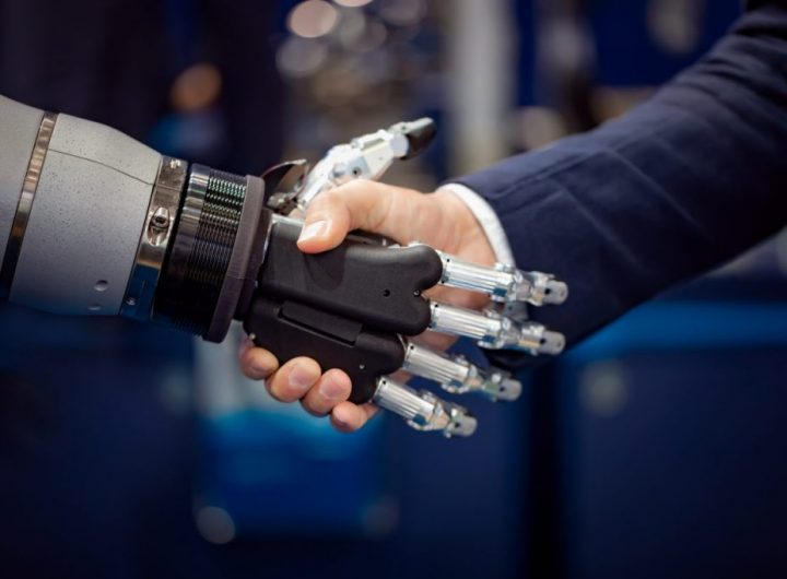 hand-of-a-businessman-shaking-hands-with-a-android-GYDH3MX-1024x682