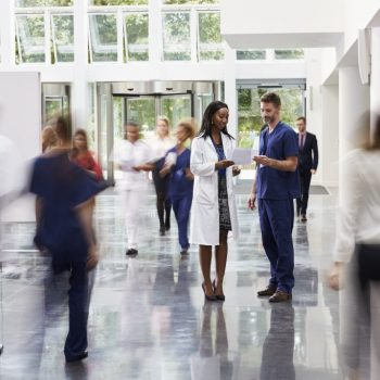 staff-in-busy-lobby-area-of-modern-hospital-PXDLXWT